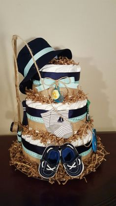 Fishing themed diaper cake! Baby shower centerpiece gift.  It's a boy! Check out my Facebook page Simply Showers for more pics and orders.  https://m.facebook.com/adorablegifts