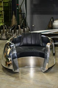 This beautiful custom piece of aviation furniture is a chair is made from a DC9 inlet cowl and polished to a mirror finish. The cushions are custom up...