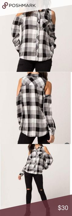 Cold shoulder plaid top Beautiful cold shoulder plaid shirt with chest pocket, button front, button cuff long sleeves. Curved hem. Very cute with skinny jeans. Tops