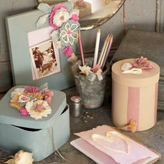 Book, box, photo frame decorated with flowers in tissue paper folded, wrinkled, twisted