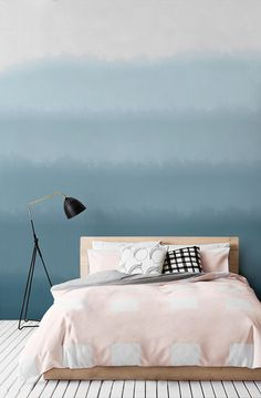 Rest easy under these watercolor waves. This wallpaper design encapsulates the tranquility of ocean waves in a wonderfully modern and abstract way. It works a dream in bedroom spaces.