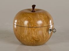 """A gorgeous hand carved """"treenware"""" box in the shape of an apple with a lid and an interior lined in silver leaf carved from a single piece of applewood. Please notice the stem of the sapple has been carved from ebony to give an entirely lifelike appearance to this amazing piece of artisanal wood working skill."""