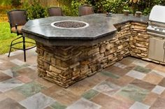 Concrete outdoor counter top with a little fire pit in the center. SWEET!