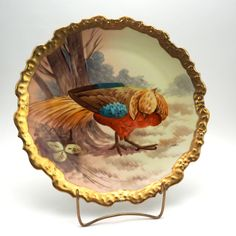 """Coronet Limoges Charger, Golden Pheasant, 13"""" Hand Painted Signed Artist Norys, Antique 1906-1920, Gold Scalloped Edge, Red, Yellow, Blue by GBCsLegacies on Etsy Golden Pheasant, Amazing Shopping, Brighten Your Day, Decorative Plates, Vintage Items, Porcelain, Hand Painted, Yellow, Blue"""