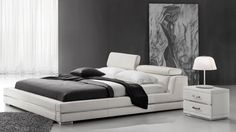 Nothing embodies true class and pure sophistication in modern design like our Hera Platform Bed. From the detailed chrome feet and rails to her contemporary ivory colored genuine leather adjustable headboard, Hera will reign over your bedroom like a Greek goddess and make all of your design prayers come true.