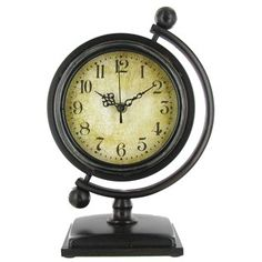 For an elegant addition to your home, try this brown metal globe table clock.   Shop Hobby Lobby