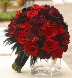 I love this bouquet with the black velvet roses, but it needs more orange.