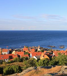 "This beautiful view of the city of Gudhjem on the danish island Bornholm is also the name of the famous Danish piece of dark bread with smoked herring, egg yolks, onions and radishes called ""Sol over Gudhjem"""