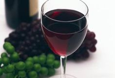 Red wine is a double-edged sword in the world of health and wellness: it may help reduce the risk of disease, however alcohol in general has been shown to negatively impact overall health status. The skins and seeds of red grapes contain antioxidants -- flavonoids and reservatol -- that may help reduce bad LDL cholesterol levels, increase good HDL...
