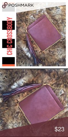 🛍SALE CHIC CROSSBODY |  WOVEN GOLD ACCENTS Chic fashionable cross body in mauve/burgundy color- Faux leather with metallic sheen. -Pull-through woven chain with goldtone hardware -Magnetic snap inside closure -inside zipper pocket perfect for ID and credit cards Bags Crossbody Bags