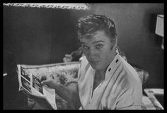 """At his 1034 Audubon Drive home in Memphis, TN. This photo of Elvis with a fresh haircut that he had gotten earlier that day at Jim's Barber Shop on Main Street in Memphis was taken by journalist Lloyd Shearer in the last week of July 1956, on assignment for """"Parade"""" magazine. Elvis is reading an entire magazine about himself. Take a look at the cover of the mag: https://de.pinterest.com/pin/380906080965163196/"""