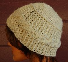 The detail in this hat is just exquisite!  This beautifully knitted pattern can be worn all over town.  The creamy white hat will look great against dark hair colors.