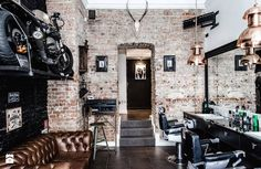 Barberian Academy & Barber Shop a cool and special barber shop in Poland. Rock decoration with vintage details and industrial design, special details the lamps and the wall. #theBmag #barberdesign #barbelife