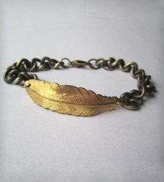 "Feather Bracelet   A feather charm accents a 7.5"" brass chain bracelet.   Bracelets"