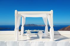 Santorini, Greece. White and blue, just like the colors of the National Flag of Greece. The wedding in dream.  About One Photo a Day: As we publish one fresh phototo a handful of social media platformsdaily for promotion, wekeepit … Read More