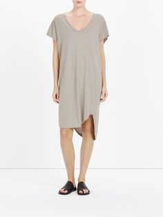 boxy t.shirt dress with tail: boxy fit t.shirt dress with low scoop neck. heritage bind detail on arms and neckline. twisted side seams with an asymmetric hemline and tail. lightweight cotton jersey with a softly textured grain.100% organic cotton superfine jersey
