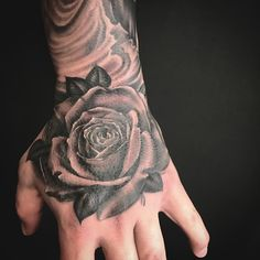 Rose tattoo on a hand. Black and grey addition to a sleeve.
