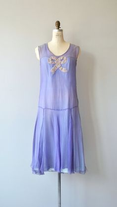 Vintage 1920s periwinkle silk crepe chiffon dress with blush sequin bow, classic drop waist unfitted shape, see through with baby blue unattached slip. --- M E A S U R E M E N T S --- fits like: medium bust: up to 37 waist: up to 34 hip: up to 44 length: 46 brand/maker: n/a condition: excellent ✩ layaway is available for this item To ensure a good fit, please read the sizing guide: http://www.etsy.com/shop/DearGolden/policy ✩ more vintage dresses ✩ http:...