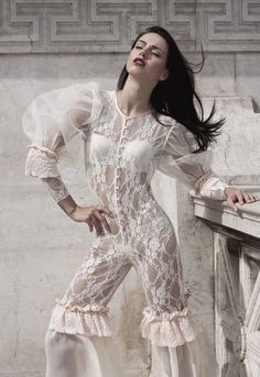 A white elastic lace jumpsuit with sheer bubble sleeves handmade in Greece by Stavrianna Georgiadi