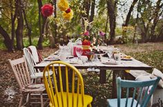 love the multi color wood chairs, Love the pale pink mixed with blue & red.. this is exactly why I am collecting chairs... out side dinning:)