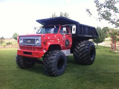 How radical is this 1981 Chevy dump truck fitted with tires for working in soft sand, mud, or grass?
