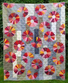 """Dresden Flower quilt, 60 x 80"""", by Monika Huelsebusch.   Oakshott Fabrics"""