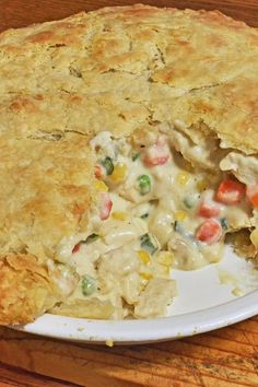 Recipe including course(s): Entrée; and ingredients: black pepper, butter, chicken, chicken broth, flour, frozen mixed vegetables, milk, onion, pie dough, potatoes, salt