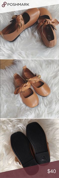 """NWT Baby girl Mary Janes with bow in chestnut Baby girl Mary Jane shoes with bow strap. Goes with EVERY outfit!! Velcro closure. Approximate foot length 5 1/2"""". The size on the bottom says 23 but I've compared it to Zara baby and it's closer to a 22) Brand new never worn. Bundle to save. All offers welcome  Shoes Dress Shoes"""
