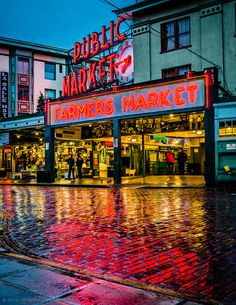 This is the Pike Place Market, in Seattle, during a beautiful drizzly morning. It's still early, the venders are setting up their stands, and there are no tourists; just a few locals chatting and watching the setup.