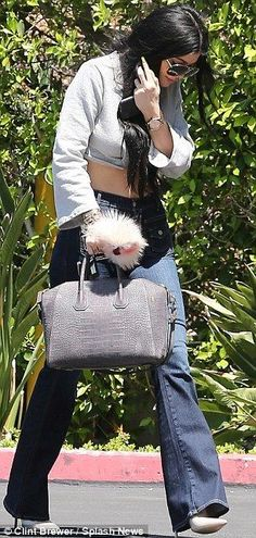 Kylie Jenner looks stylish in retro bellbottom jeans and a crop top - Kylie Jenner Style