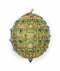 A PERIDOT, TURQUOISE AND GOLD POWDER CASE, BY JEAN SCHLUMBERGER, TIFFANY & CO. Designed as a textured 18k gold seed pod, enhanced by rectangular-cut peridot and cabochon turquoise, with polished gold detail, the bottom terminating in a cabochon emerald, opening to reveal a mirror and powder well, circa 1956.