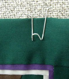 How to Bend a Paper Clip to Hang Light Objects on Cubicle Walls. Ah, the cubicle, home to office workers all over. The bland colored fabric walls are frequently supported by solid metal that refuses to admit any sort of thumb tacks or. Cubicle Walls, Work Cubicle, Cubicle Design, Office Supply Organization, Wall Organization, Cubical Ideas, Office Ideas, Cube Decor, Ideas