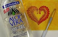 clear aloe-vera gel and inktense pencils on fabric