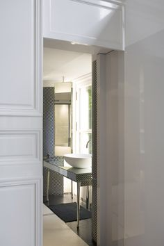 Bathroom with tiny black and white checkered tile by Tristan Auer.