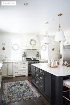 Christmas kitchen decorating using silver and gold mixed with touches of holiday greenery is the perfect mix of elegant and chic. White Cupboards, Kitchen Cupboards, Brass Kitchen, New Kitchen, Kitchen With Brass Hardware, Kitchen Reno, Black Kitchens, Home Kitchens, Dream Kitchens