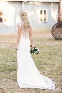 Stunning illusion-back gown: http://www.stylemepretty.com/australia-weddings/2014/06/10/laid-back-rustic-barn-wedding/   Photography: Louisa Bailey - http://www.louisabailey.com/