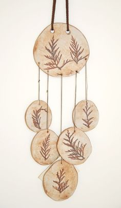 Chimes out of terracota clay. Very easy to make, great for young kinds, could use leaves etc to press onto pieces or could have them make each piece representative of camp or themselves.