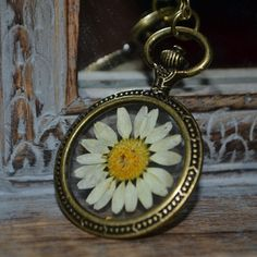 Items similar to Real Daisy Necklace in Resin in large round bronze setting - Handmade Flower Jewellery on Etsy Daisy Necklace, Resin Jewellery, Botanical Flowers, Handmade Flowers, Pocket Watch, Bronze, Unique Jewelry, Handmade Gifts, Accessories