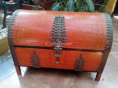 An Exotic One of A Kind Dream Chest in Burnt Orange and Large Ornate Brass decorations with a clasp and lock that is itself a piece of art like a Mang Tikka. Painted in black on the interior, it has an additional velvet and satin lining with Gold trimming available on demand for those who wish an exclusive experience of luxury. A Prince of the past was known to have carried his cocktail cabinet in this in his Car Booth. Hold your breath! Wipe with a damp cloth. Place moth balls. Use as you…