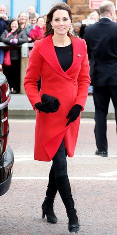 Catherine Middleton WHAT SHE WORE Middleton showed her Maternity style in a Red Coat and Black Accessories including knee-high suede boots.