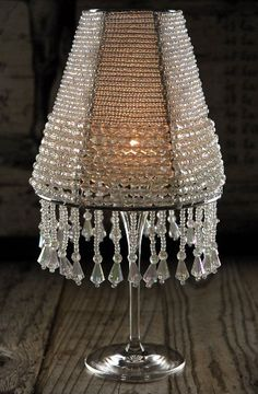 Crystal Wine Glass Lamp Shades $19 each at www.save-on-crafts.com.  Just place a battery operated tealight in a wine or champagne glass and set the shade over it.  Beautiful!