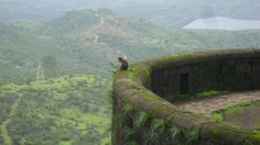 A solitary sentinel surveys the kingdom - Lohagad Fort ruins (Marathi: लोहगड, iron fort) is one of the many hill forts of the Maharashtra state in the Pune district of India. http://en.wikipedia.org/wiki/Lohagad