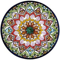 These beautifully handcrafted Talavera plates by the renowned Tomas Huerta   ceramic studio will make a vibrant and cultural addition to any space in your home. With over 100 unique designs in this expansive collection, you're sure to find one that fits your taste. Every authentic Talavera plate is handmade in Puebla, Mexico, and is 100% lead free; chip and crack resistant; as well as microwave, oven, and dishwasher safe! There is even an eyelet on the back of each plate for easy wall…