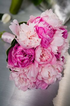 Light and dark pink peony bouquet for the bride.