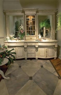 Awesome vanity! I want something like this in the master bathroom. Ok maybe not so luxurious but the same set up with mirrors and sinks on each side. Plus the cabinet in the middle to store things I use everyday so I could keep the counters free of clutter.