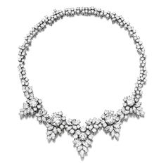 Diamond Necklace, Cusi. The front highlighting five brilliant-cut diamonds weighing 5.41, 5.10, 2.15, 2.01 and 1.74 carats, embellished with marquise-shaped and circular-cut diamonds weighing 20.00 carats in total, mounted in platinum and 18 karat white gold, signed Cusi, two diamonds weighing 5.41 and 5.10 carats can be detached from the necklace.