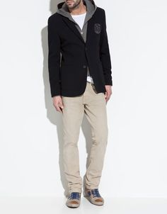 casual, pique blazer with gray hoodie and tan jeans or cords