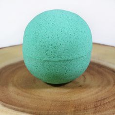 Well Wisher Bath Bomb by Soothing Sloth Soap Co.  A bath bomb that wishes the mind, body, and soul well. Packed with tea tree and muscle rescue essential oils, this bath bomb will help you combat any negativity that may come your way and leave you feeling fresh with scents of aloe, clover, and bamboo. Relax with bright green waters and get ready to spread your positivity.   Order at: soothingsloth.com