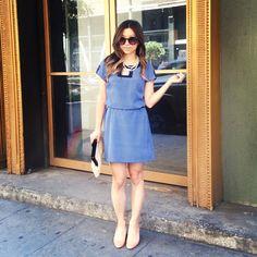 work wear: blue shift dress, belted.