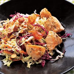 Asian Salad with Salmon:  simple broiled salmon gets a boost from a flavorful Asian salad accompaniment made of shredded napa and red cabbage with carrots, sweet onion, toasted almonds, and dried apricots, and dressed with a mixture of rice vinegar, sesame oil, and honey.